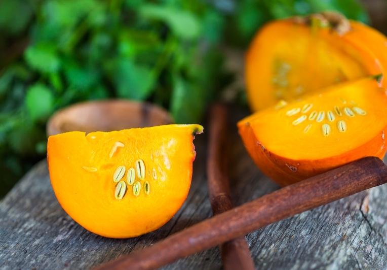 cut pumpkin with cinnamon