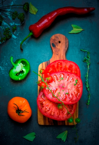 tomato and pepper on the board